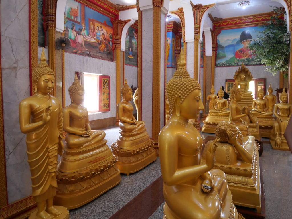 Golden statues of Buddha inside the Wat Chalong Temple